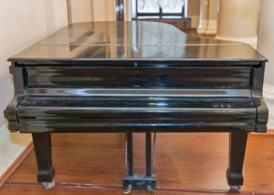 Giffen Furniture Removals Get The Piano Ready